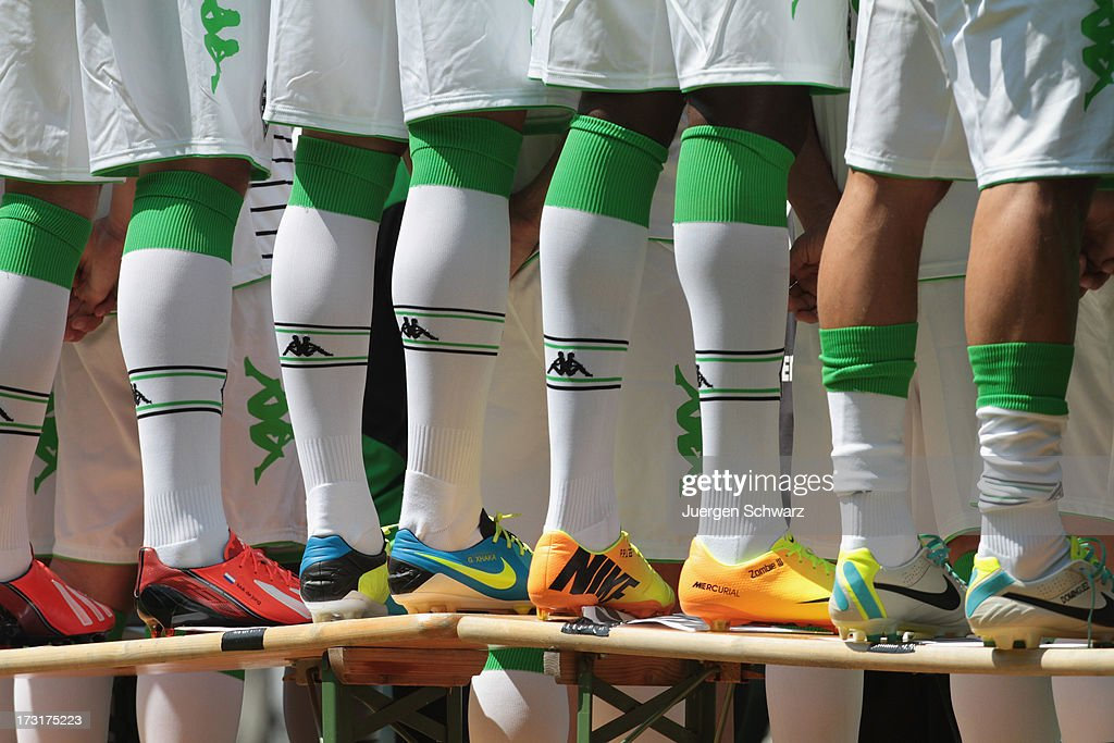 Players stand on benches during the team presentation of Borussia Moenchengladbach on July 9, 2013 in Moenchengladbach, Germany.