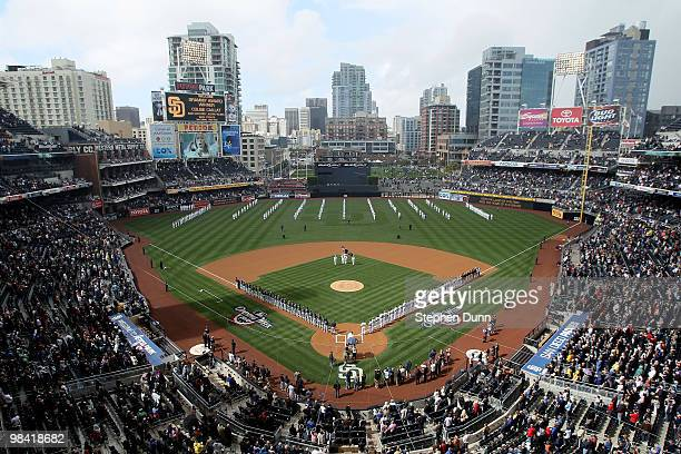 Players stand on the field during the natioinal anthem before the game between the Atlanta Braves and the San Diego Padres on April 12, 2010 at Petco...