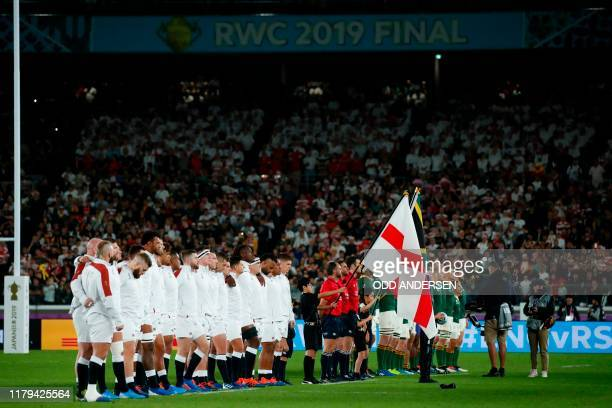 Players stand on the pitch before the Japan 2019 Rugby World Cup final match between England and South Africa at the International Stadium Yokohama...