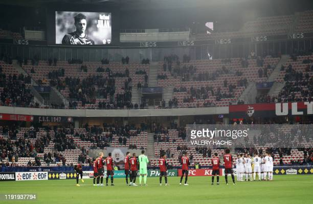 Players stand on the pitch during a tribute to Nathael Julan, a French player for EA Guingamp who died in a car accident two days ago, before the...