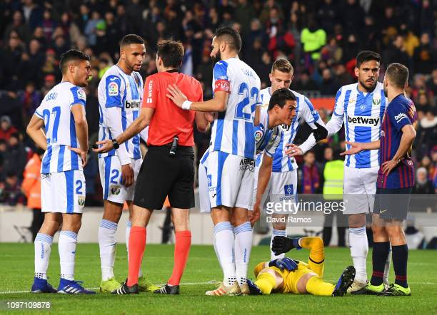 Players stand over anaAn injured Ivan Cuellar of Leganes during the La Liga match between FC Barcelona and CD Leganes at Camp Nou on January 20 2019...
