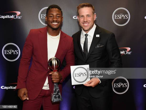 NFL players Stefon Diggs and Case Keenum pose with the award for Best Moment during The 2018 ESPYS at Microsoft Theater on July 18 2018 in Los...