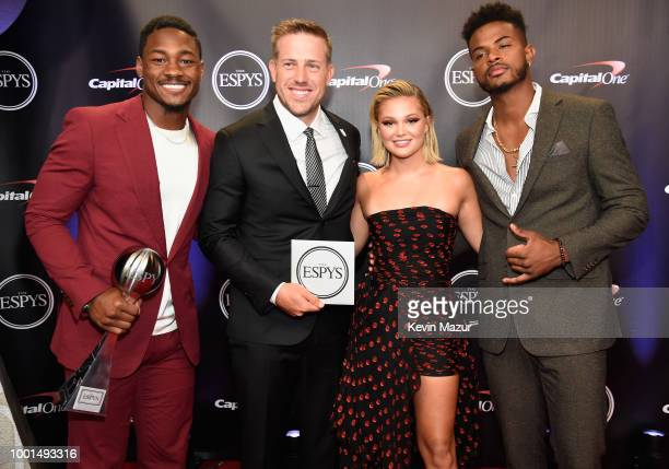 NFL players Stefon Diggs and Case Keenum recipients of the award for Best Moment and actors Olivia Holt and Trevor Jackson pose during The 2018 ESPYS...