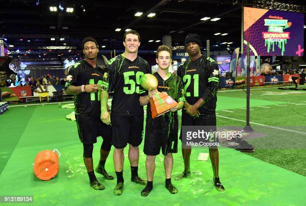 NFL players Stefon Diggs Luke Kuechly actor Ricardo Hurtado and former NFL player Deion Sanders attend the Superstar Slime Showdown taping at...