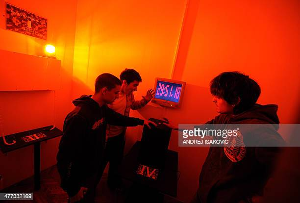 Players stop the countdown clock in a room while taking part in the virtual Escape Room game in Novi Sad on January 31 2014 Those fed up with...
