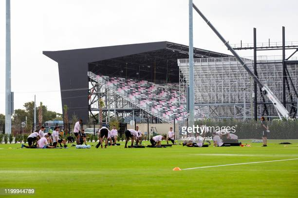 Players stretch on the field as the new stadium is being built in the distance during Inter Miami's first practice at their new training site former...