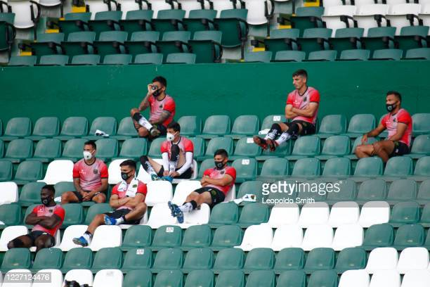 Players subtitutes of FC Juarez looks on during a match between Leon and FC Juarez as part of the friendly tournament Copa Telcel at Leon Stadium on...