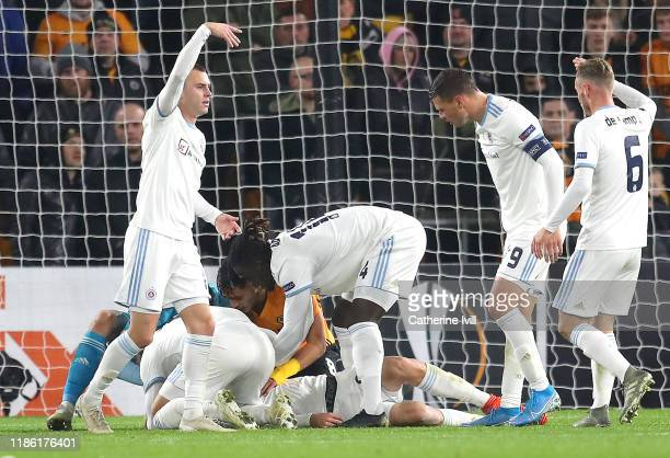 Players surround Kenan Bajric of Slovan Bratislava after he goes down following a challenge during the UEFA Europa League group K match between...