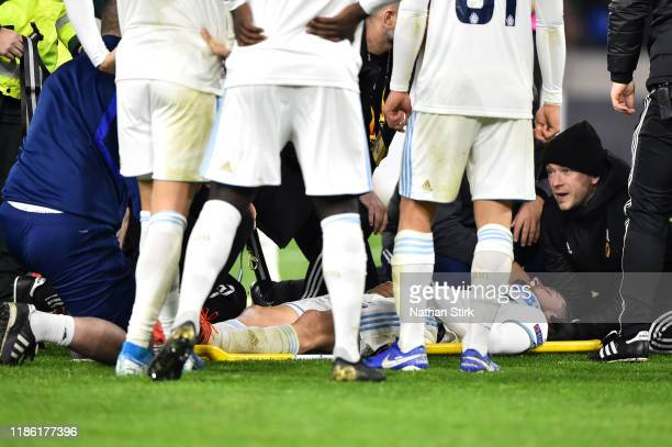 Players surround Kenan Bajric of Slovan Bratislava after he is given treatment following a challenge during the UEFA Europa League group K match...