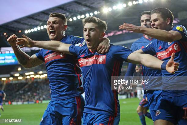 Players surround Lynden Gooch of Sunderland after he scores the first goal during the Sky Bet League One match between Milton Keynes Dons and...