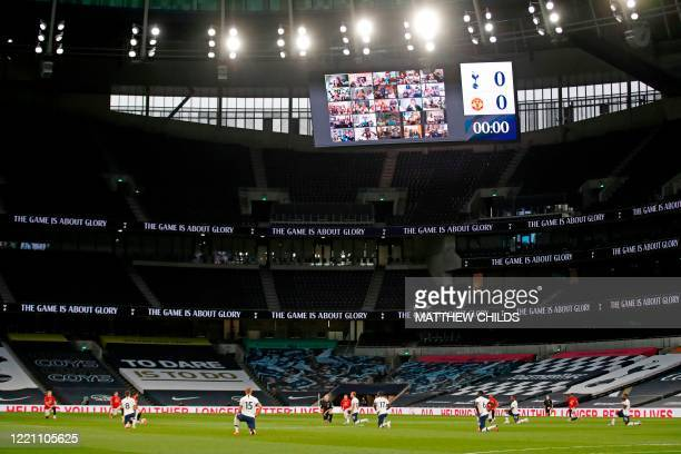 Players take a knee at the beginning of the game during the English Premier League football match between Tottenham Hotspur and Manchester United at...