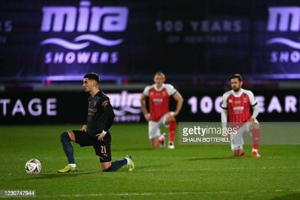 Players 'take a knee' in support of anti-racism campaigns ahead of the English FA Cup ahead during the English FA Cup fourth round football match...