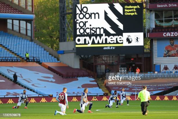 Players 'take a knee' in support of the No Room For Racism campaign ahead of the English Premier League football match between Aston Villa and West...