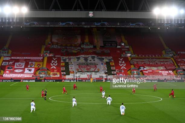 Players 'take a knee' in support of the No Room For Racism campaign ahead of the UEFA Champions League Group D stage match between Liverpool FC and...