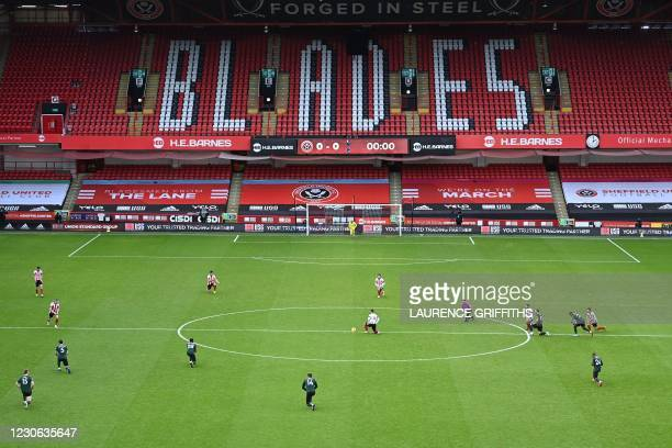 Players take a knee is support of Black Lives Matter ahead of the kick off during English Premier League football match between Sheffield United and...