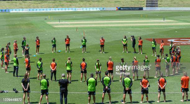 Players take part in a barefoot ceremony prior to the Women's Big Bash League WBBL match between the Perth Scorchers and Sydney Thunder at Blacktown...