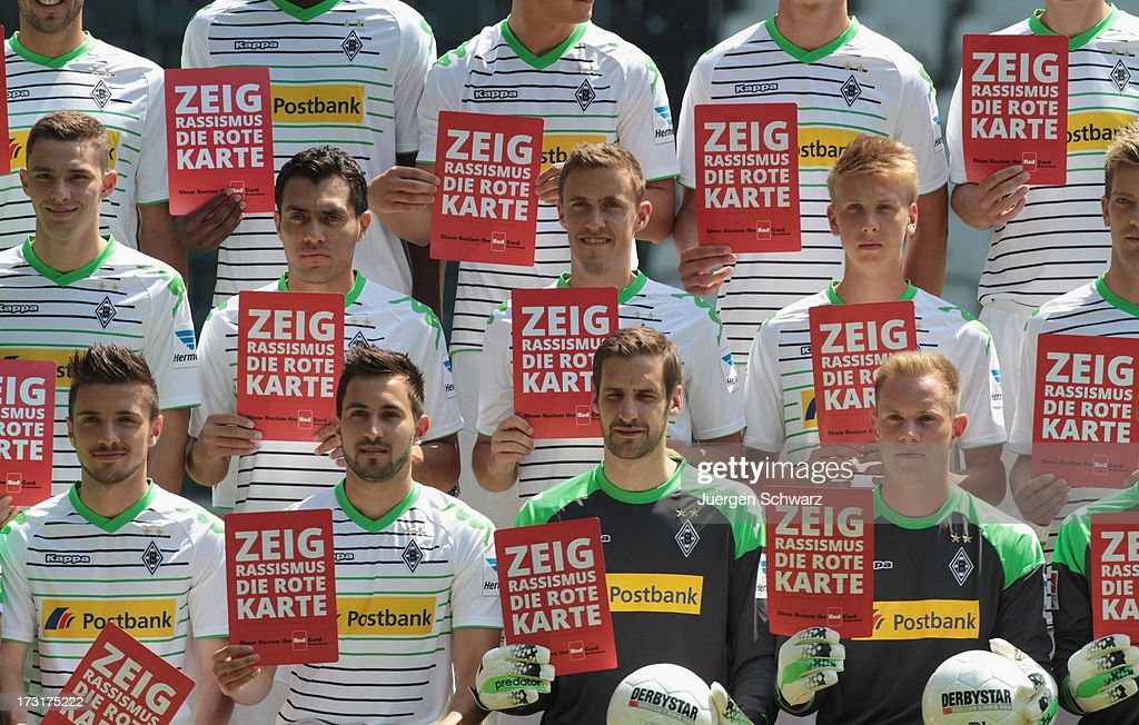 Players take part in a campaign 'show red card to racism' during the team presentation of Borussia Moenchengladbach on July 9, 2013 in Moenchengladbach, Germany.