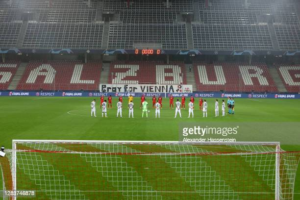 Players take part in a minutes silence in respect of those effected by the terrorist attack in Vienna prior to the UEFA Champions League Group A...