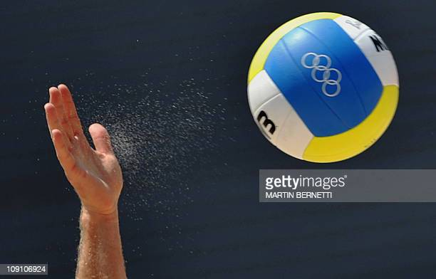 Players take part in a training session at the Chaoyang Park Beach Volleyball Ground ahead of the 2008 Olympic Games in Beijing on August 2 2008 The...