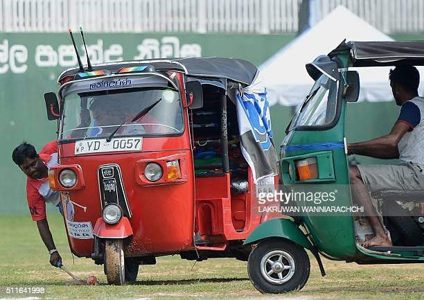 Players take part in a tuktuk polo match as part of a promotional event organized by a local Sri Lankan leasing company in the southern town of Galle...