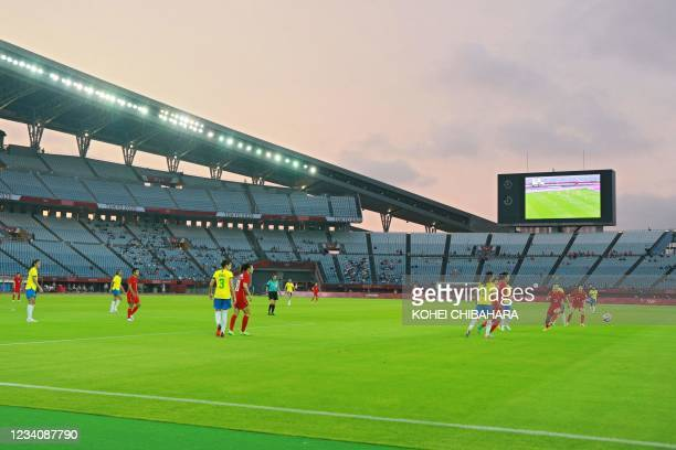 Players take part in the Tokyo 2020 Olympic Games women's group F first round football match between China and Brazil at the Miyagi Stadium in Miyagi...