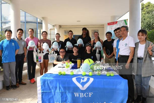 Players take photos at Wuhan Baiji Dolphin House on Day 3 of 2019 Dongfeng Motor Wuhan Open at Optics Valley International Tennis Center on September...