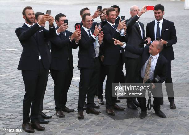 Players take pictures of their wives and partners before the Ryder Cup gala dinner at the Palace of Versailles ahead of the 2018 Ryder Cup on...