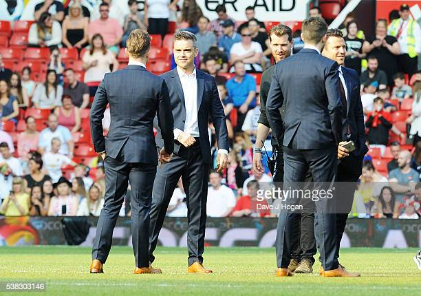 Players take the feild during Soccer Aid at Old Trafford on June 5 2016 in Manchester England