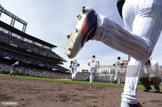 Players take the field before the game The Colorado Rockies played the San Diego Padres Friday April 8 2016 on opening day at Coors Field in Denver...