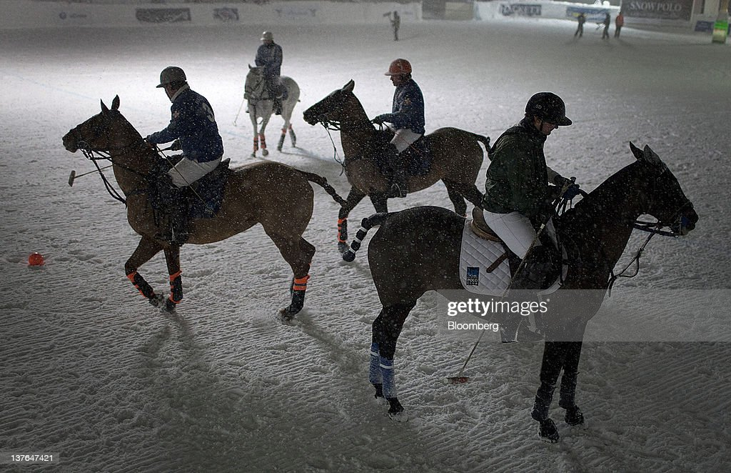 Players take to the field at the annual Klosters Snow Polo event in Klosters, Switzerland, on Friday, Jan. 20, 2012. German Chancellor Angela Merkel will open next week's World Economic Forum in Davos, Switzerland, which will be attended by policy makers and business leaders including U.S. Treasury Secretary Timothy F. Geithner. Photographer: Scott Eells/Bloomberg via Getty Images
