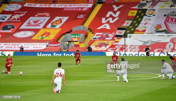 Players thak the knee before kick off during the English Premier League football match between Liverpool and Crystal Palace at Anfield in Liverpool,...