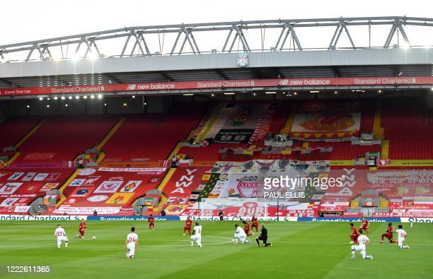 Players thak the knee before kick off during the English Premier League football match between Liverpool and Crystal Palace at Anfield in Liverpool...
