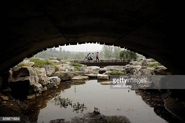Players through the bridge during the final round of the Volvo China open at Topwin Golf and Country Club on May 1 2016 in Beijing China