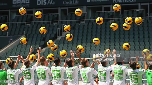Players throw balls during the Borussia Moenchengladbach team presentation on July 9 2013 in Moenchengladbach Germany