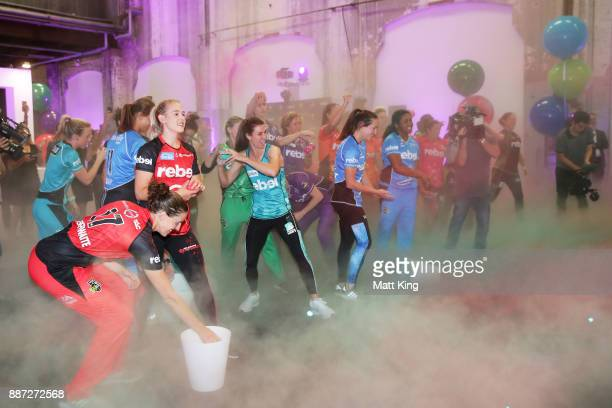 Players throw Christmas baubles at a white backdrop during the 201718 WBBL Women's Big Bash League season launch at Carriageworks on December 7 2017...