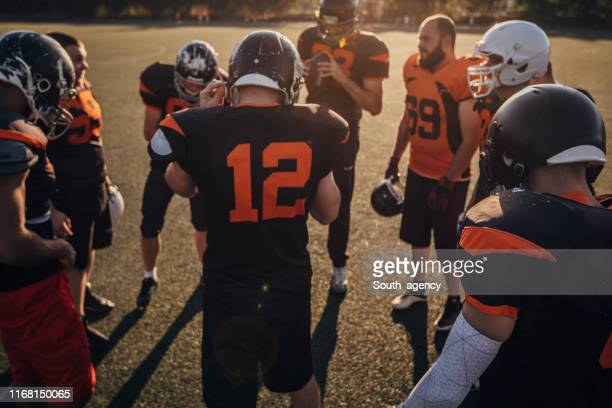 nfl players time out on field - ncaa stock pictures, royalty-free photos & images