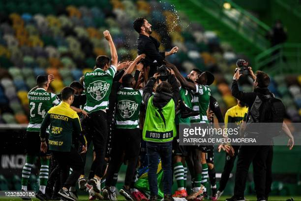 Players toss Sporting's head coach Ruben Amorim after winning the Portuguese League football match between Sporting Portugal and Boavista and the...