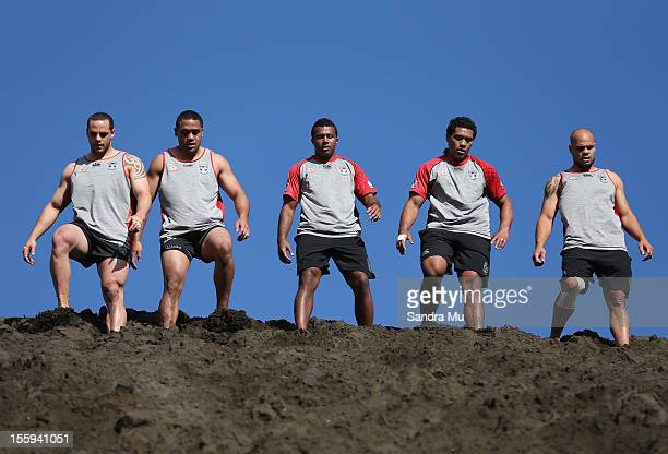 Players train on the sand dunes during the New Zealand Warriors NRL training session at Bethells Beach on November 10 2012 in Auckland New Zealand...