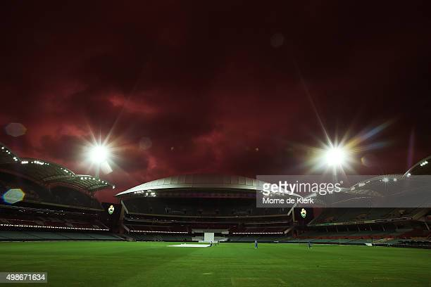 Players train under lights during an Australian nets session at the Adelaide Oval on November 25 2015 in Adelaide Australia