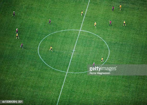 Players training in soccer field, aerial view