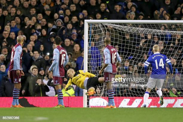 Players turn to watch Aston Villa goalkeeper Bradley Guzan fail to stop Everton's Kevin Mirallas from scoring their second goal of the game