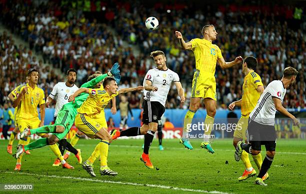 Players tussle during the UEFA EURO 2016 Group C match between Germany and Ukraine at Stade PierreMauroy on June 12 2016 in Lille France
