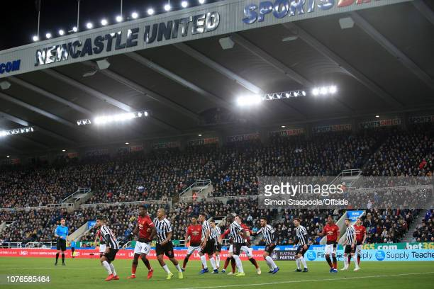 Players tussle for position during the Premier League match between Newcastle United and Manchester United at St James' Park on January 2 2019 in...