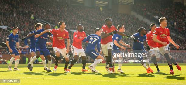 Players tussle for position during the Premier League match between Manchester United and Chelsea at Old Trafford on February 25 2018 in Manchester...