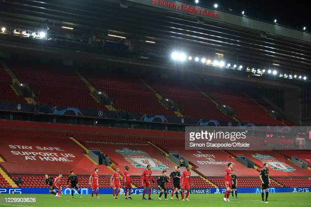 Players tussle for position in front of empty seats during the UEFA Champions League Group D stage match between Liverpool FC and Ajax Amsterdam at...