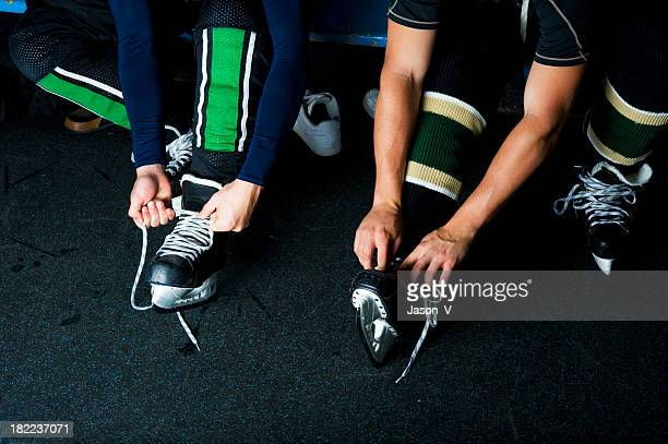 Players tying Skates