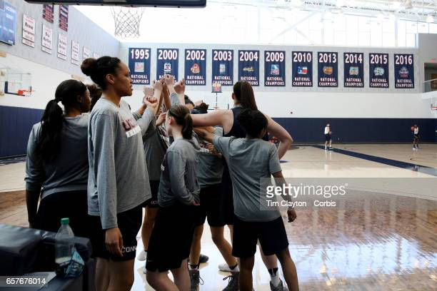 Players unite after warming up under the supervision of strength coach Amanda Kimball during the The UConn Huskies women's basketball team training...