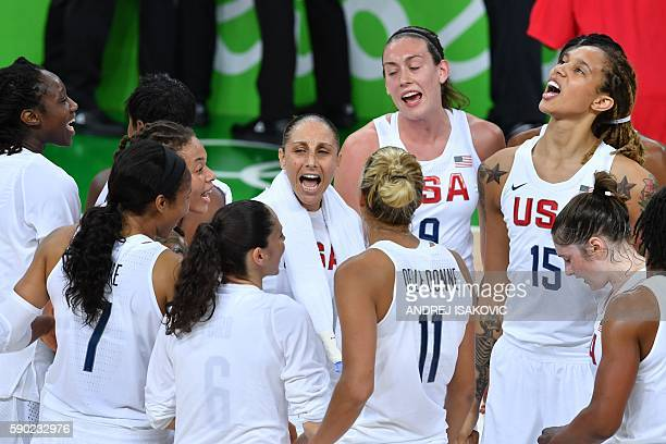 USA players unite around USA's guard Diana Taurasi after USA defeated Japan in a Women's quarterfinal basketball match between USA and Japan at the...