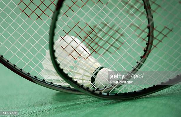 Players use their rackets to prepare the shuttlecock for action on August 16, 2004 during the Athens 2004 Summer Olympic Games in Olympic Hall at the...