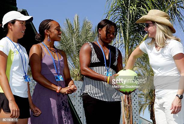 Players Vania King, Angela Haynes and Asha Rolle, with the help of spectator Tanna Bayola, participate in the main draw ceremony for the Pacific Life...